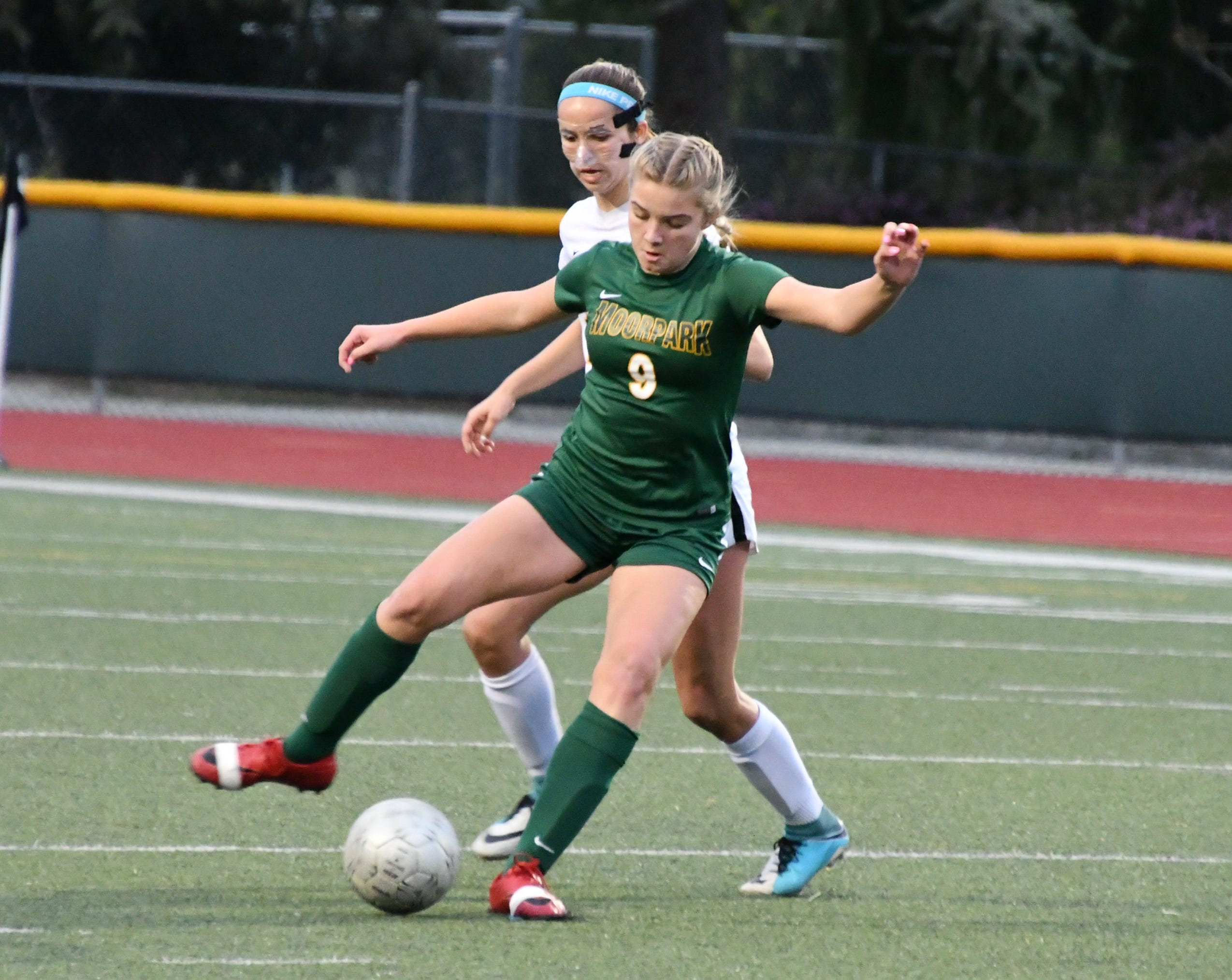 Moorpark High freshman striker Jennifer Bill holds the ball up against Manhattan Beach-Mira Costa on Tuesday night in the CIF-Southern Section Division 2 quarterfinals. Mira Costa won, 3-2.