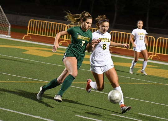 Moorpark High winger Mia Aguilar battles for a ball against Manhattan Beach-Mira Costa on Tuesday night in the CIF-Southern Section Division 2 quarterfinals. Mira Costa won, 3-2.