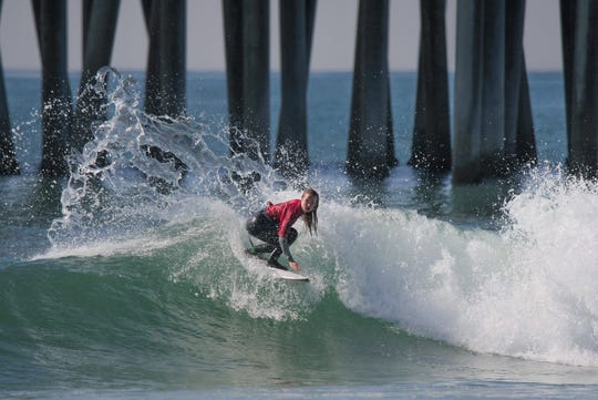 Ventura's Makena Burke won the Under-16 division at the USA Surfing Prime event in Huntington Beach last Sunday.