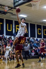 Caleb Gilbert soars to the hoop during Ventura's second-round playoff loss to Highland on Tuesday night.