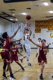 Isaiah Montano takes a shot in traffic during Ventura's home playoff loss Tuesday night.