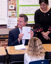 Governor Gavin Newsom explains the legislative process to students during a surprise visit to Riverview Elementary School on Wednesday, February 13, 2019 to sign his first bills as Governor. The bills provide urgent assistance for communities that have contaminated and unsafe water and also support communities that have been rocked by California wildfires. Senator Melissa Hurtado, 14th Senate District, is at right.