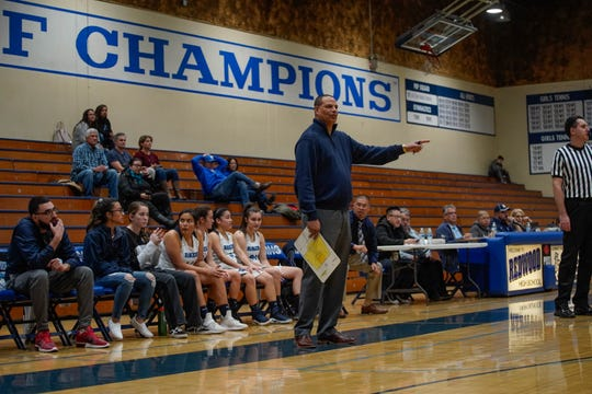 Redwood's Jason Black coaches against Morro Bay on Tuesday in a Central Section playoff game.