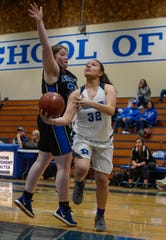 Redwood's Janessa Haro drives past Morro Bay's Emme Haas during the Central Section Division II first-round playoff game Tuesday in Visalia.