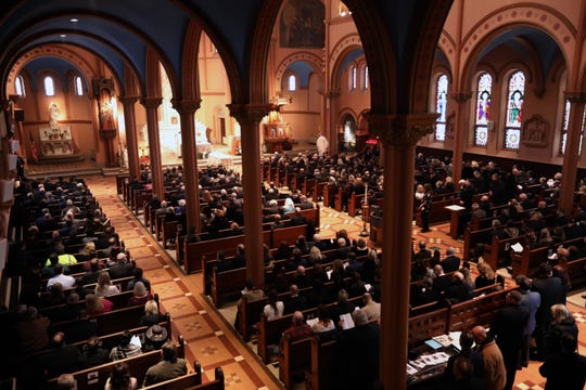 Mourners gather for the funeral of Leonard Spano, former Westchester legislator and county clerk, at St. Mary's Church in Yonkers Feb. 13, 2019.
