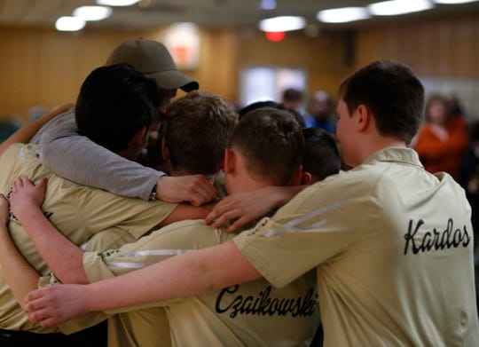 The Clarkstown boys bowling team embrace after winning Wednesday's Section One tournament in East Fishkill on February 13, 2019.