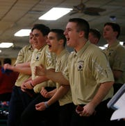 The Clarkstown boys bowling team react to a strike from Michael O'Malley during Wednesday's Section One tournament in East Fishkill on February 13, 2019.