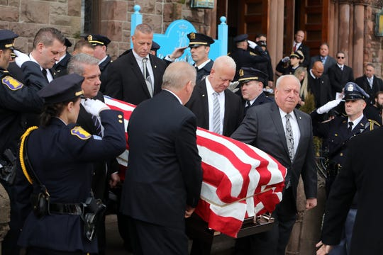 The family of Leonard Spano carries his casket after the funeral at St. Mary's Church in Yonkers Feb. 13, 2019.