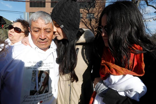 Jose Sanchez, the grandfather of Valerie Reyes, her aunt Monica Gudino, and cousin Desiree Rodriquez gather together outside St. Gabriel's Church in New Rochelle on Feb. 13, 2019 before the funeral of Reyes, the New Rochelle woman whose body was found in a suitcase in Greenwich, Connecticut, last week. An ex-boyfriend has been arrested.
