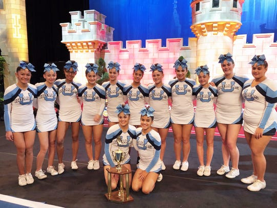 Ursuline's cheerleading team is all smiles after finishing ninth at cheerleading nationals and third at worlds in Florida.