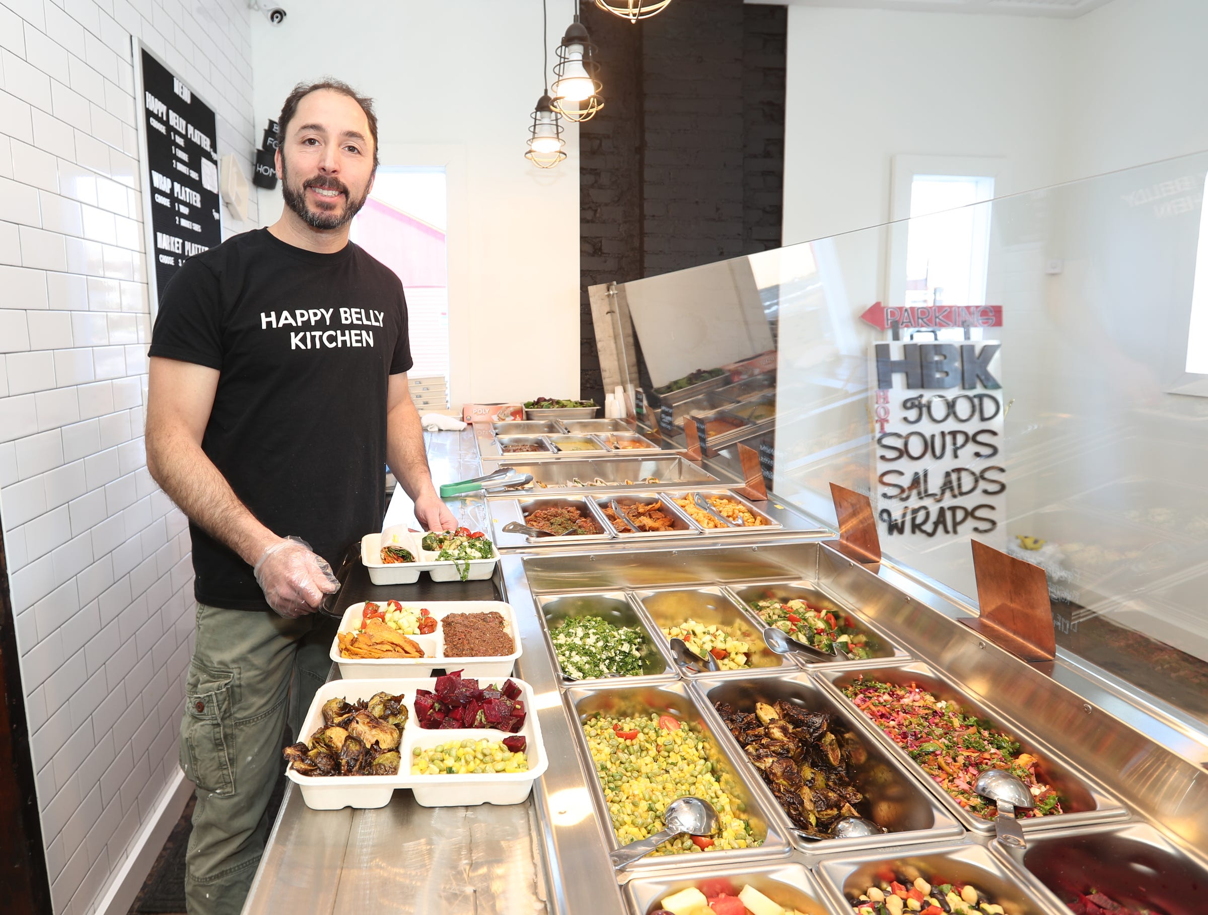 Ilan Nifco, co-owner, prepares lunches at Happy Belly Kitchen in Sloatsburg on Wednesday, February 13, 2019.