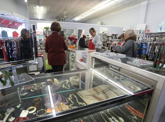 """The Marie Kondo """"Tidying Up"""" craze is benefitting thrift shops including The Golden Shoestring in Larchmont, which has seen an uptick in donations since New Year's Day when Netflix series first aired. Customers shop at the purses at The Golden Shoestring in Larchmont Feb. 13, 2019."""
