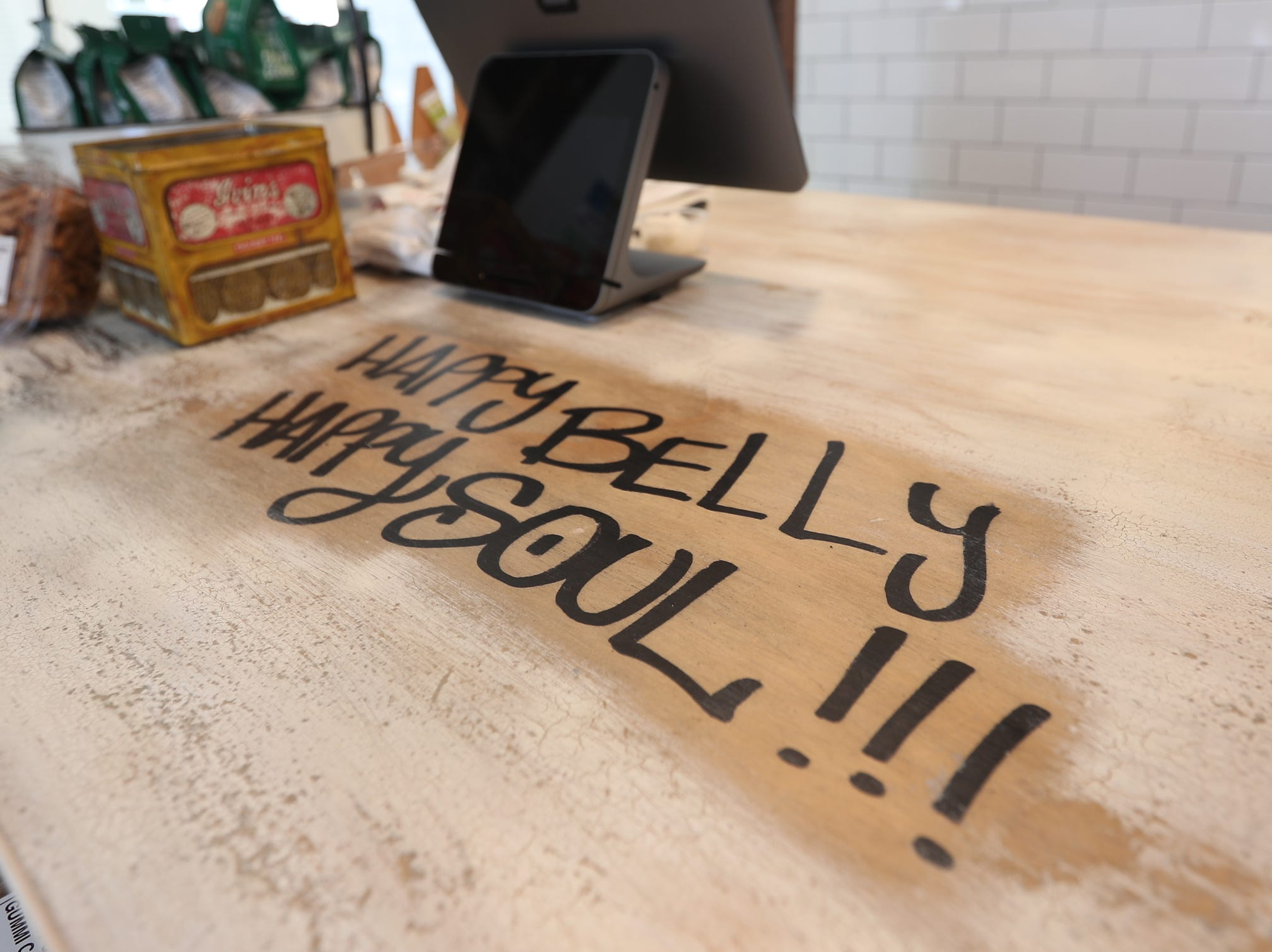 Happy Belly Kitchen slogan on the counter in Sloatsburg on Wednesday, February 13, 2019.