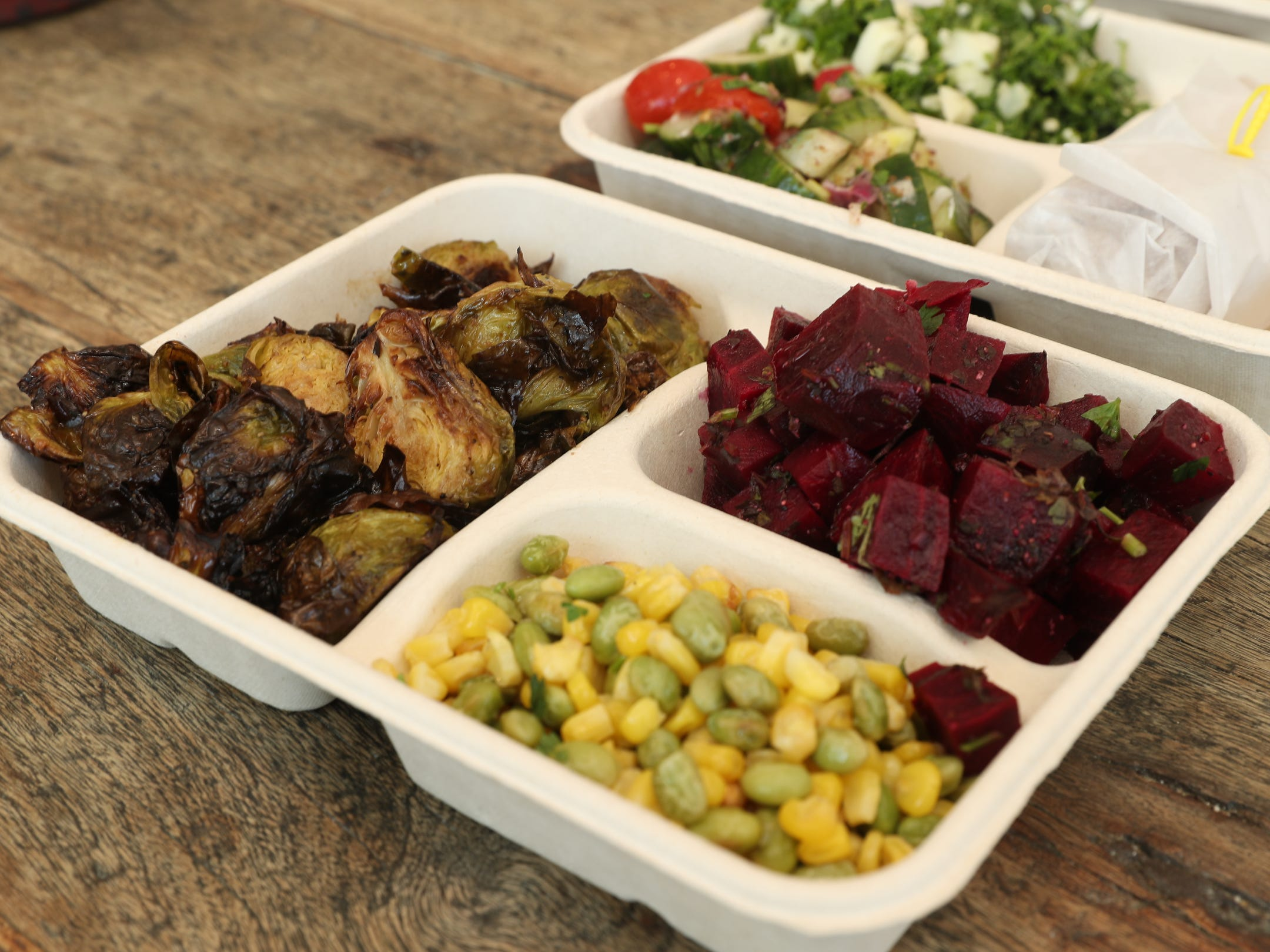 The Market Platter, with Roasted Brussel sprouts, lime edamame and corn, and raw spicy beet salad on the menu at Happy Belly Kitchen in Sloatsburg on Wednesday, February 13, 2019.