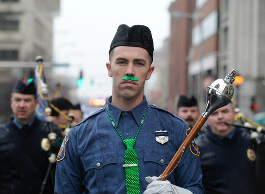 Wilmington Police Department Cpl. Thomas Oliver, recently charged for rape, marched in the 2015 St. Patrick's Day Parade as a drum major.