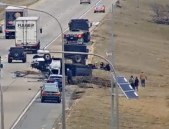 An overturned tractor-trailer slows traffic on I-495 into Pennsylvania on Wednesday afternoon.