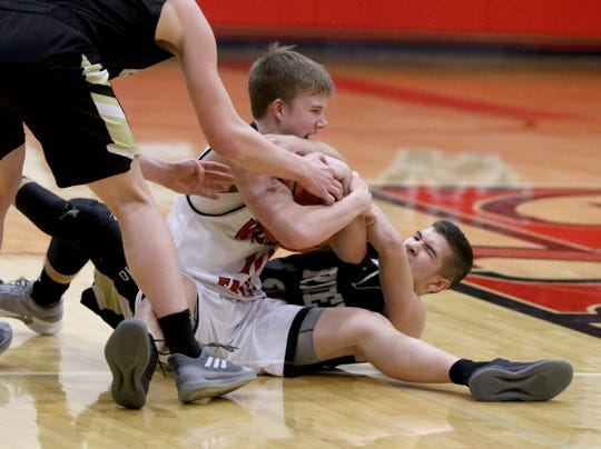 Wichita Falls High School's Jack Murdock and Rider's Dylan Fettkether fight for the ball Tuesday, Feb. 12, 2019, at Old High.