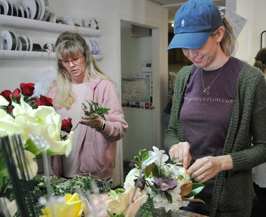 Jameson's Flowers owner, Jenny Lee Hines, right, and her mom, Lori Jameson, a floral designer, work Wednesday to keep up with the steady business that comes with being in the floral business during Valentine's season.