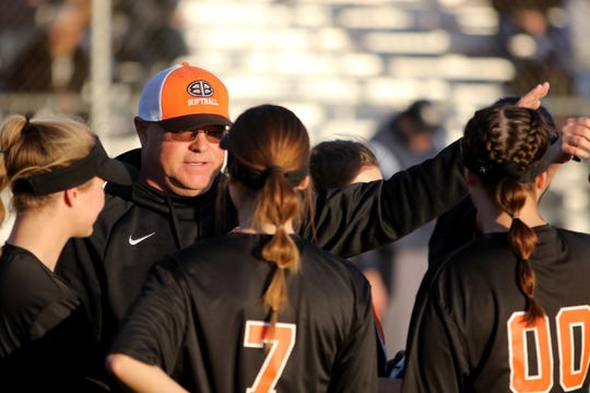Burkburnett head softball coach John Blair talks to his team during a change over inthe game against Rider Tuesday, Feb. 12, 2019, at the Sunrise Optimist Softball Complex.