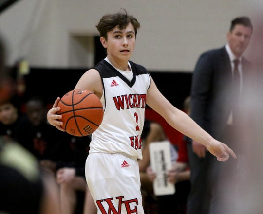 Wichita Falls High School's Trey Fenoglio dribbles in the game against Rider Tuesday, Feb. 12, 2019, at Old High.