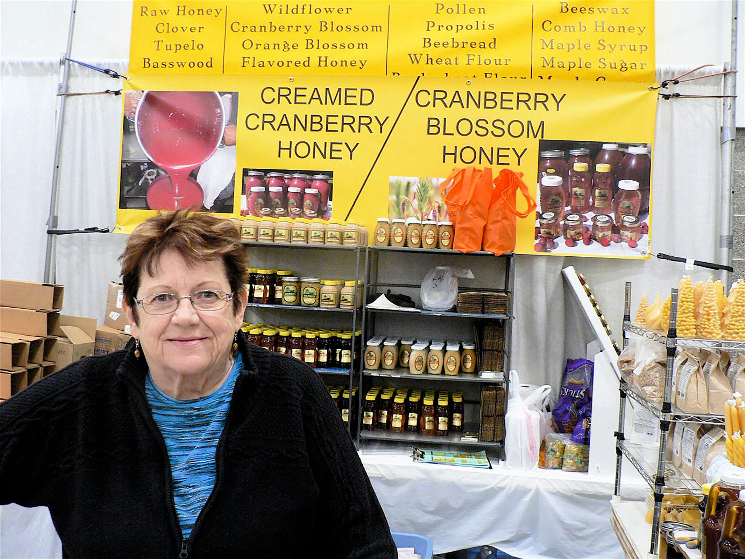 Nancy Patz and the family owned Patz Maple and Honey Farms display.