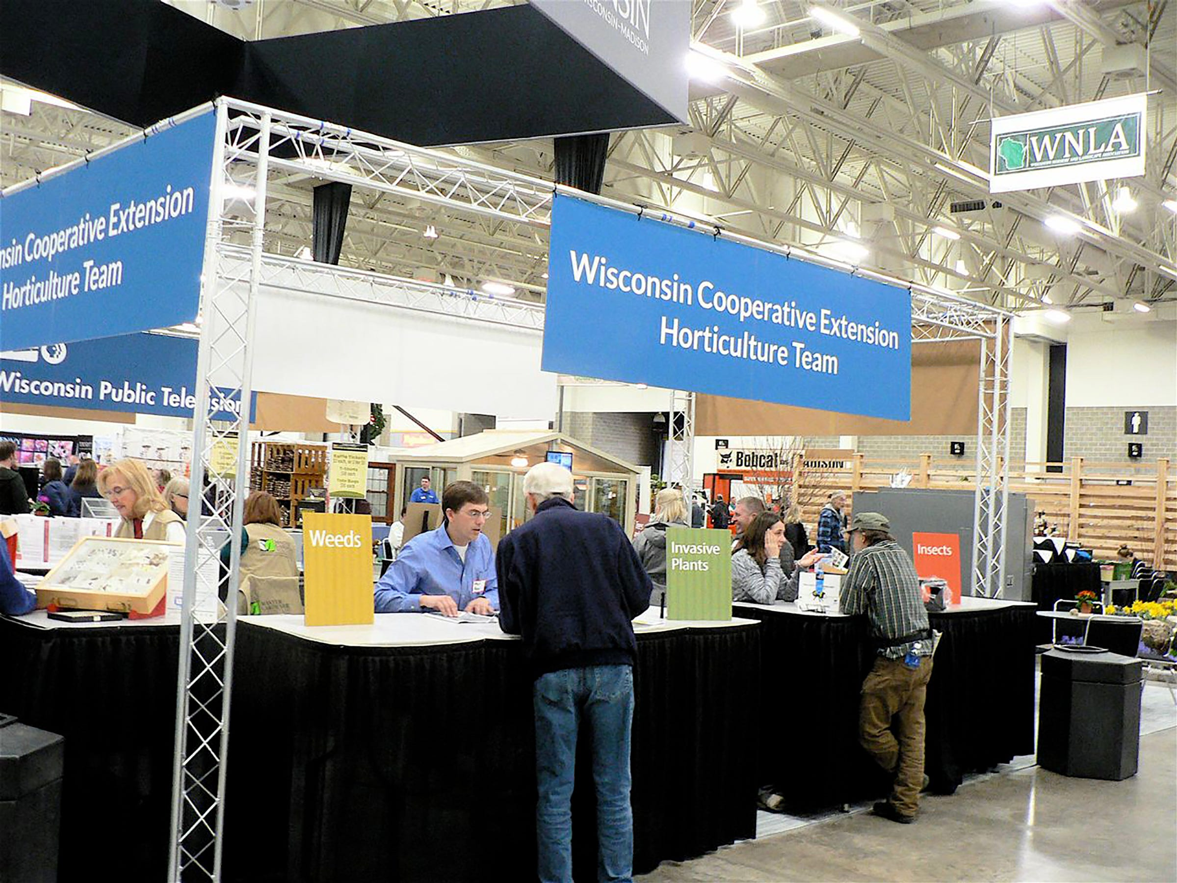 UW Cooperative Extension Horticulture team co sponsors the Expo...and answers questions.