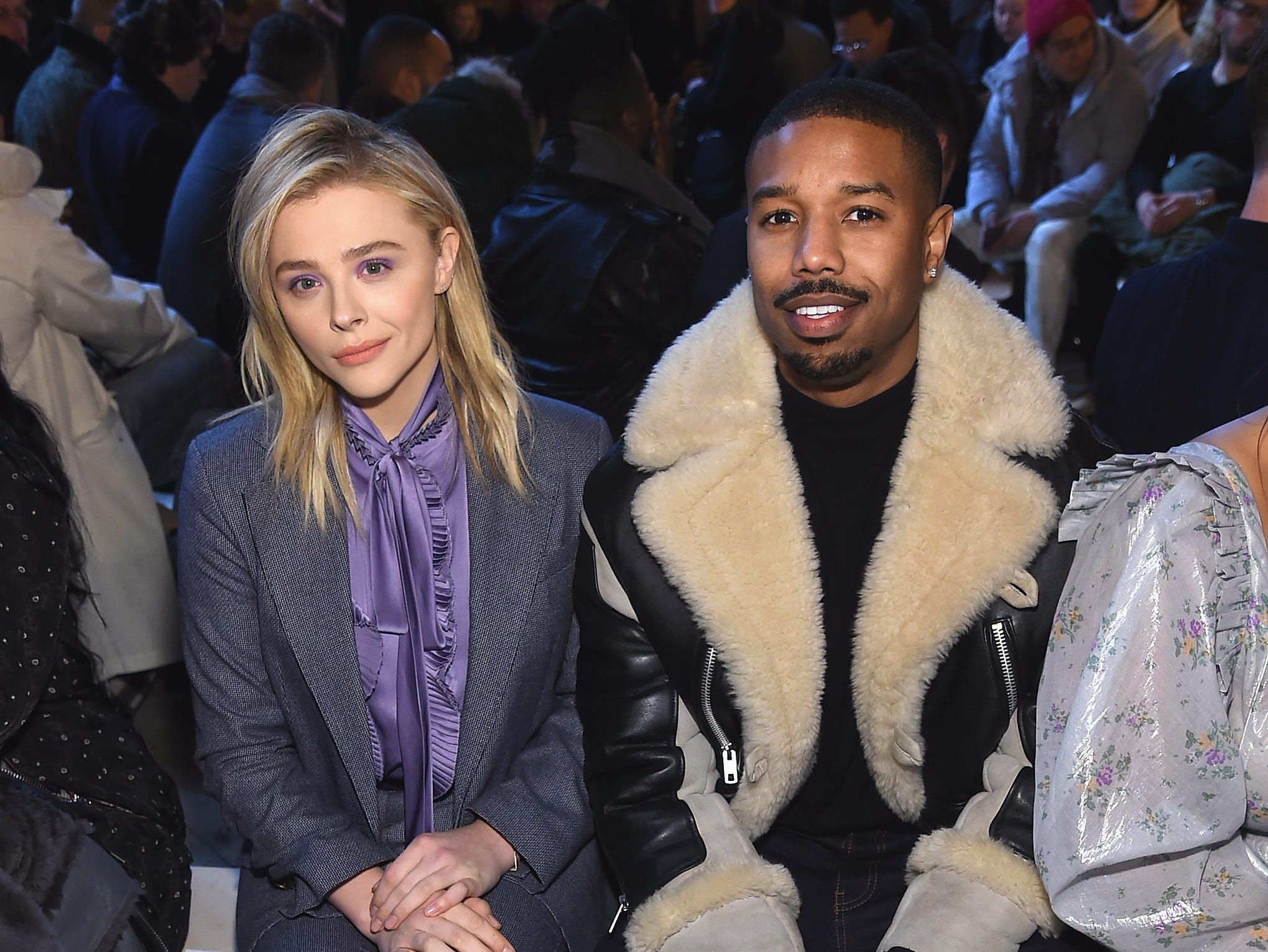 NEW YORK, NY - FEBRUARY 12: Chloe Grace Moretz (L) and Michael B. Jordan attend Coach 1941 fashion show at the NYSE on February 2019 during New York Fashion Week on February 12, 2019 in New York City.  (Photo by Jamie McCarthy/Getty Images) ORG XMIT: 775290960 ORIG FILE ID: 1124279982