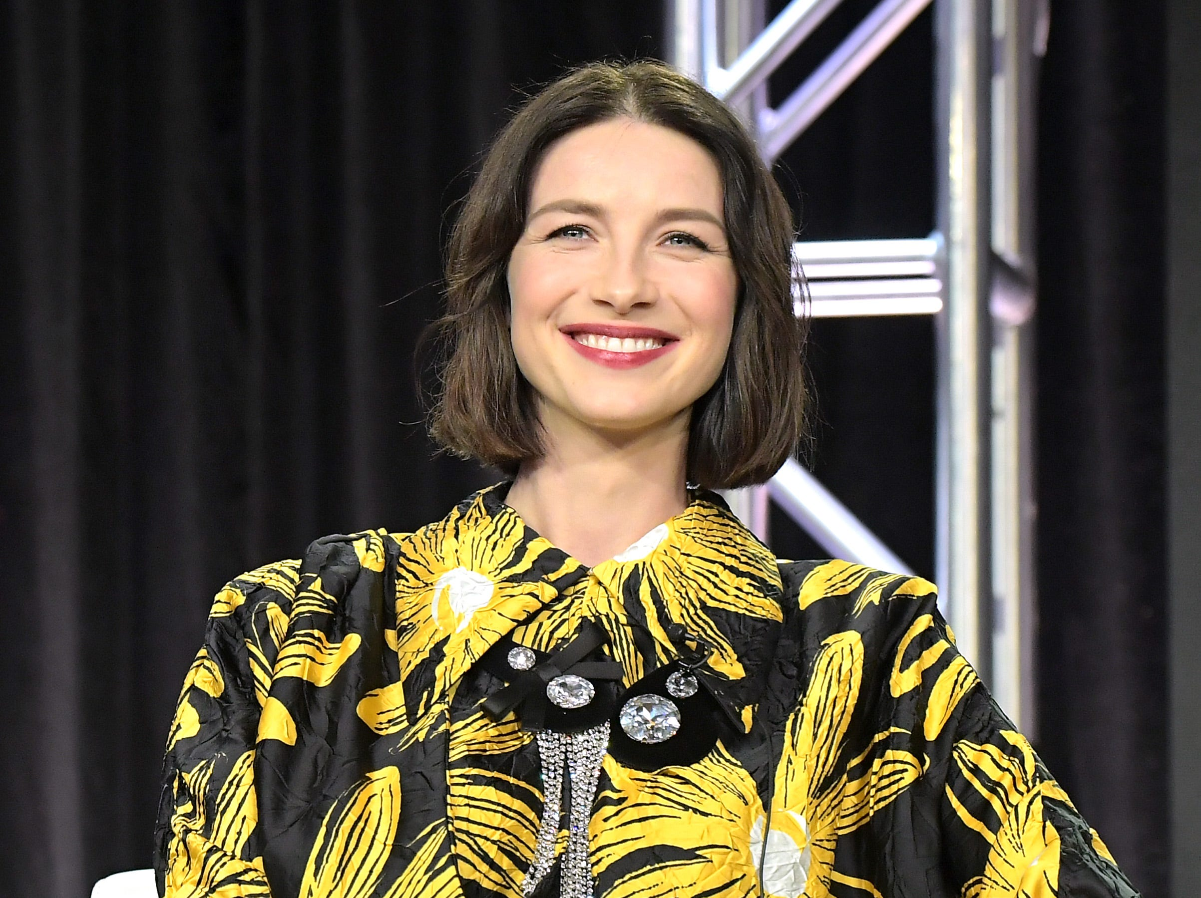 """""""Outlander"""" star Caitriona Balfe takes a question during Starz's """"Fiercely Female Panel."""""""