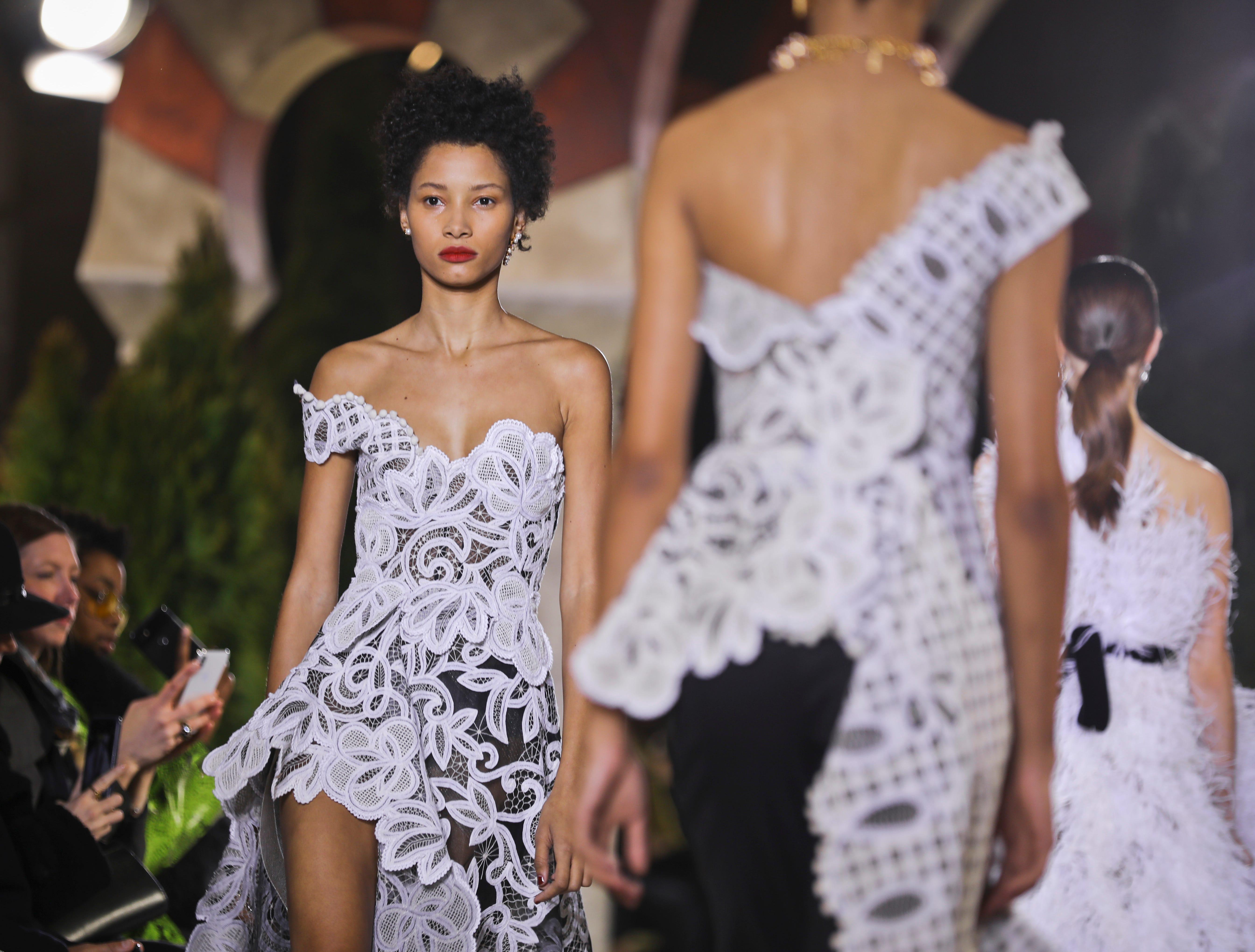 Fashion from the Oscar de la Renta collection is modeled during New York Fashion Week, Tuesday Feb. 12, 2019. (AP Photo/Bebeto Matthews) ORG XMIT: NYBM127