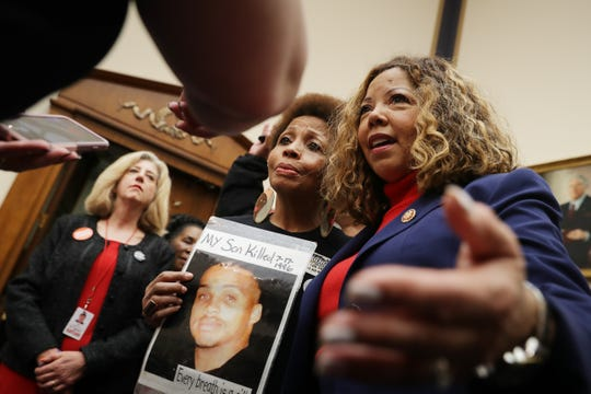 The Brady Campaign's Mattie Scott (C) and Rep. Lucy McBath (D-GA), both of who lost sons to gun violence, pose for photographs before a hearing on gun violence legislation on February 06, 2019.