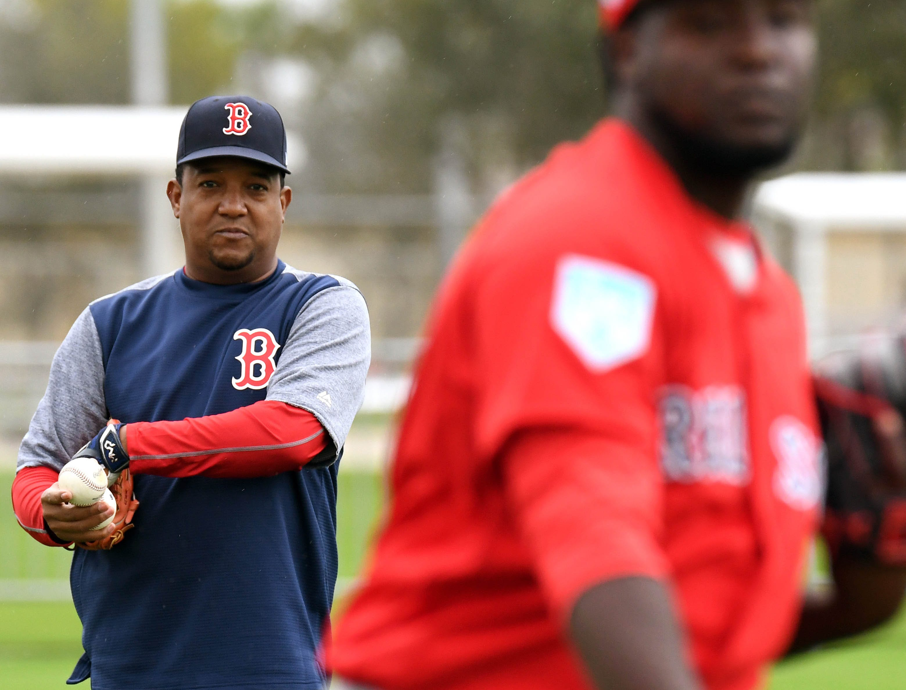 Feb. 13: Red Sox special instructor Pedro Martinez watches a group of pitchers warm up.