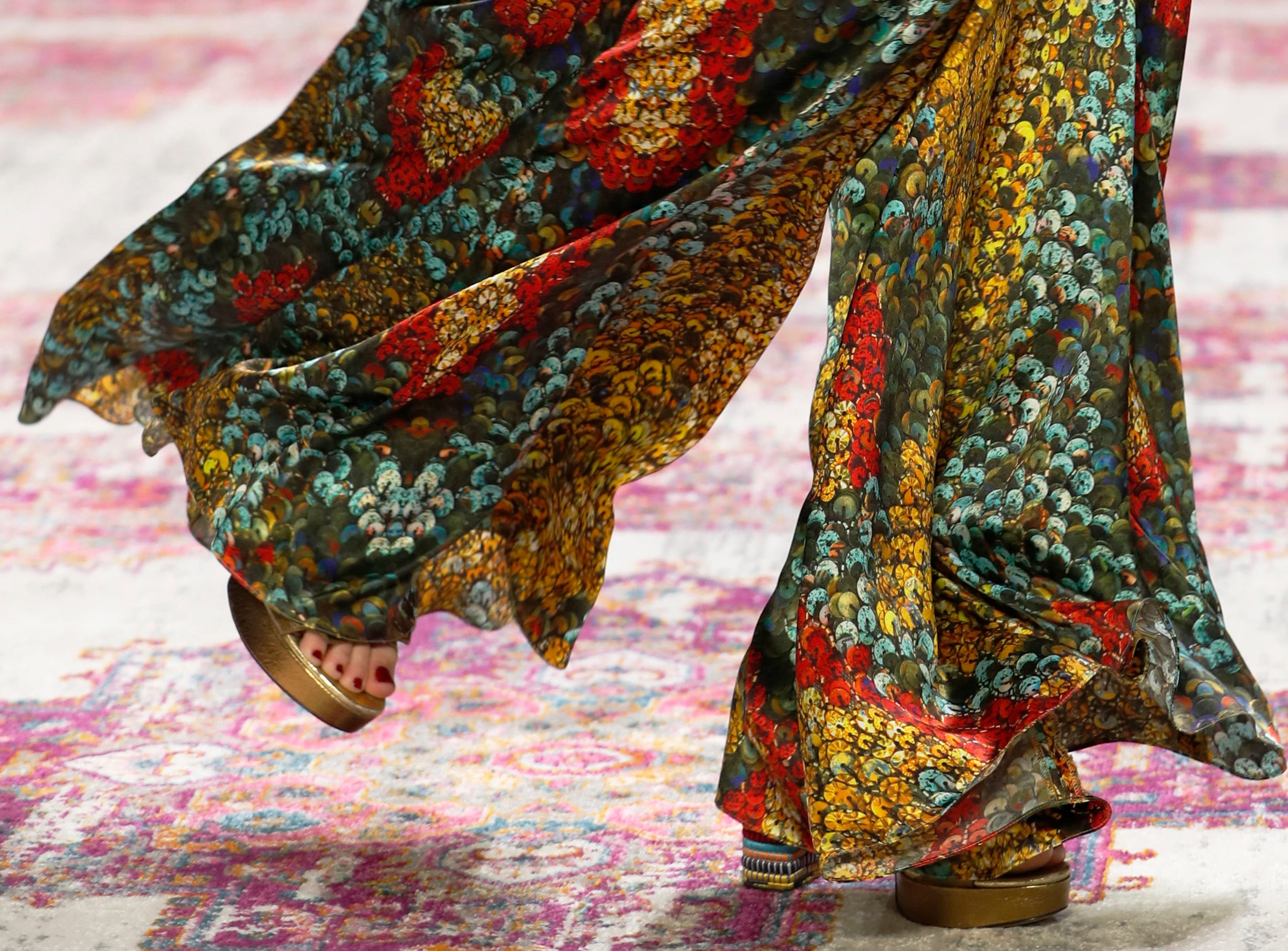 The latest fashion from Naeem Khan is modeled during New York Fashion Week, Tuesday, Feb. 12, 2019, in New York. (AP Photo/Kathy Willens) ORG XMIT: NYKW122