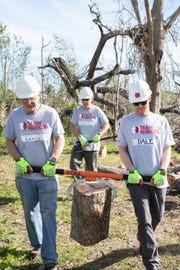 Dale Earnhardt Jr. (right) volunteered with members of disaster relief group Team Rubicon in the Florida Panhandle earlier this week.