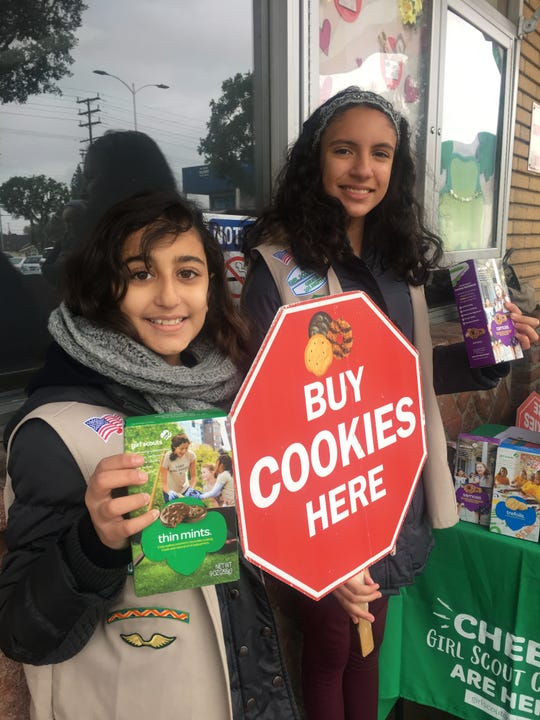 Girl Scouts Sarah Khaled, 11, left, and Sofia Estrada, 12, set up shop one chilly February day outside Brent's Deli in Northridge, California, to offer passers-by irresistible Thin Mints and other cookies. Both are from the Heart of The Valley Troop 616 in Porter Ranch, California.