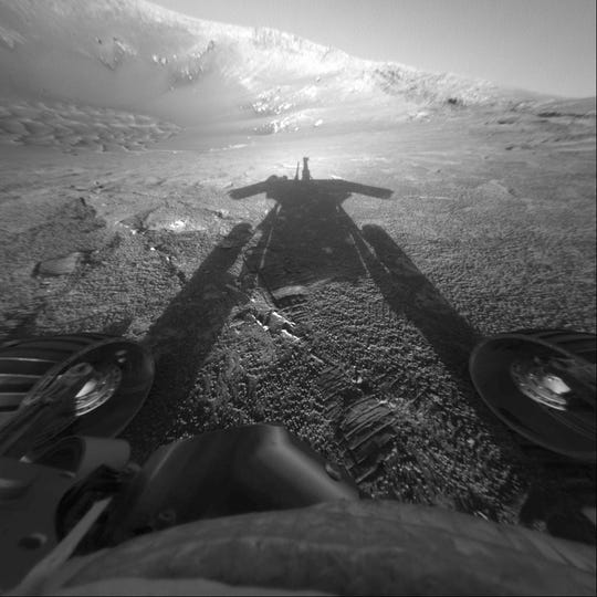 This July 26, 2004 photo made available by NASA shows the shadow of the Mars Exploration Rover Opportunity as it traveled farther into Endurance Crater in the Meridiani Planum region of Mars.