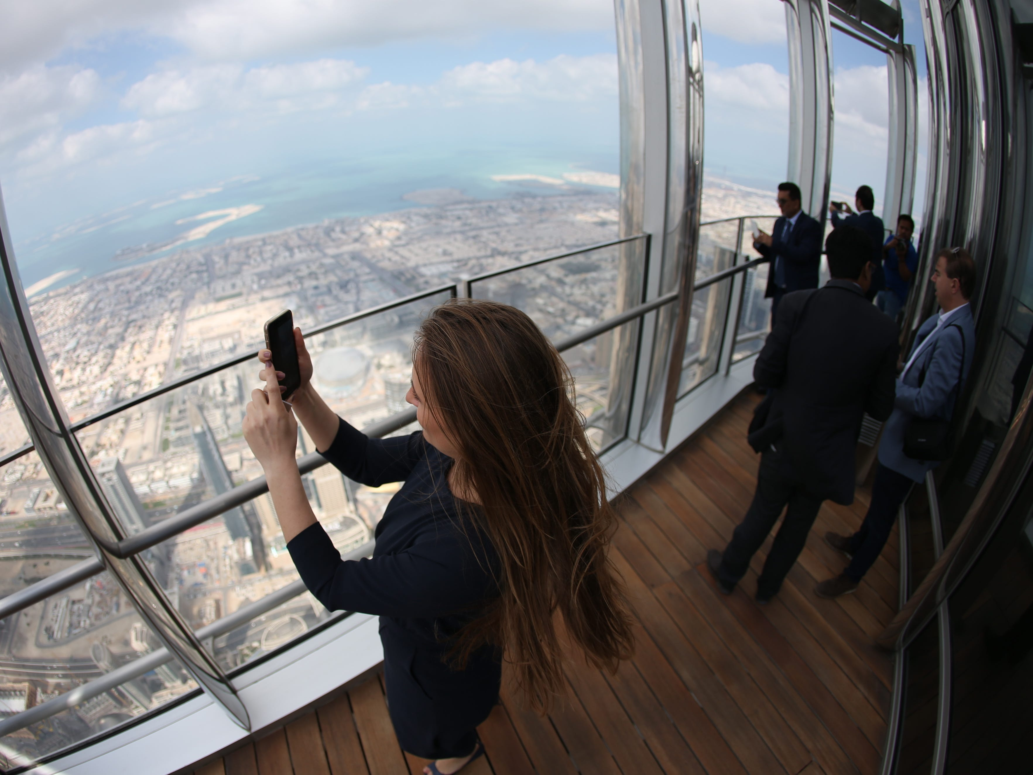 epa07366409 A picture taken with a fish eye lens shows people inspecting the new highest lounge in the world at Burj Khalifa in Dubai, United Arab Emirates, 13 February 2019. Ahmad Al Falasi, Executive Director Emaar Properties announced during media briefing the opening of highest lounge in the world at Burj Khalifa which is located at 152, 153 and 154 floor which have distinctive settings each assuring never before seen views of the city.  EPA-EFE/ALI HAIDER ORG XMIT: XAH001