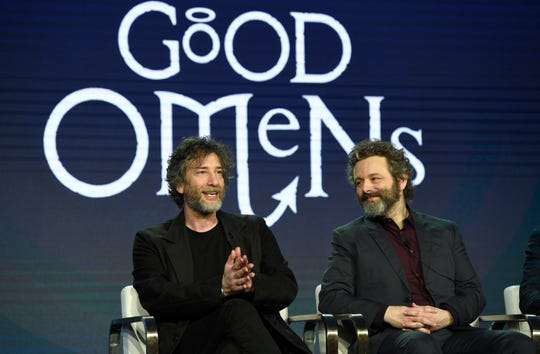 "Executive producer/showrunner Neil Gaiman, left, and Michael Sheen participate in the Amazon ""Good Omens"" panel at the Winter Television Critics Association Press Tour."