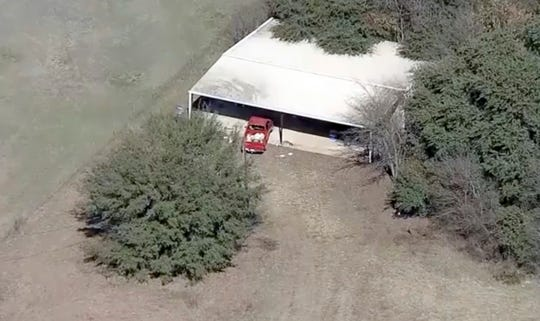 This aerial image provided by KDFW-FOX4 News shows part of the property where deputies found two young, malnourished children locked together in a dog cage near Rhome, Texas about 20 miles northwest of Fort Worth.