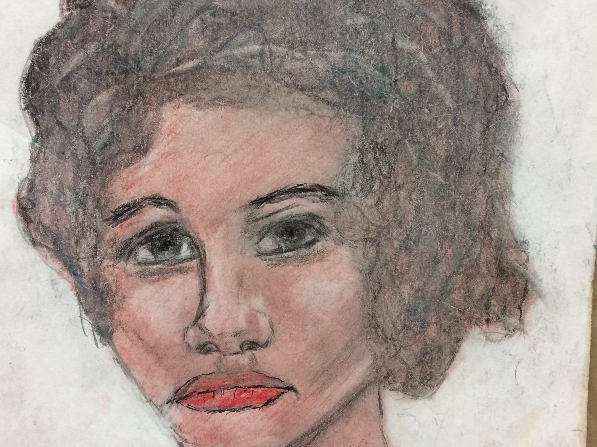 """Serial killer Samuel Little drew this woman who he says he murdered at some point between 1976 and 1979. Little told authorities she was a 26-year-old who he'd met in St. Louis, Missouri. He said she was possibly known as """"Jo."""""""