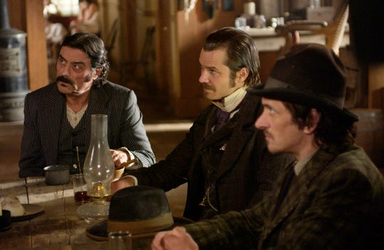 """Al Swearengen (Ian McShane), left, Seth Bullock (Timothy Olyphant) and Sol Star (John Hawkes) appear in a scene from HBO's """"Deadwood,"""" which ran from 2004 to 2006."""