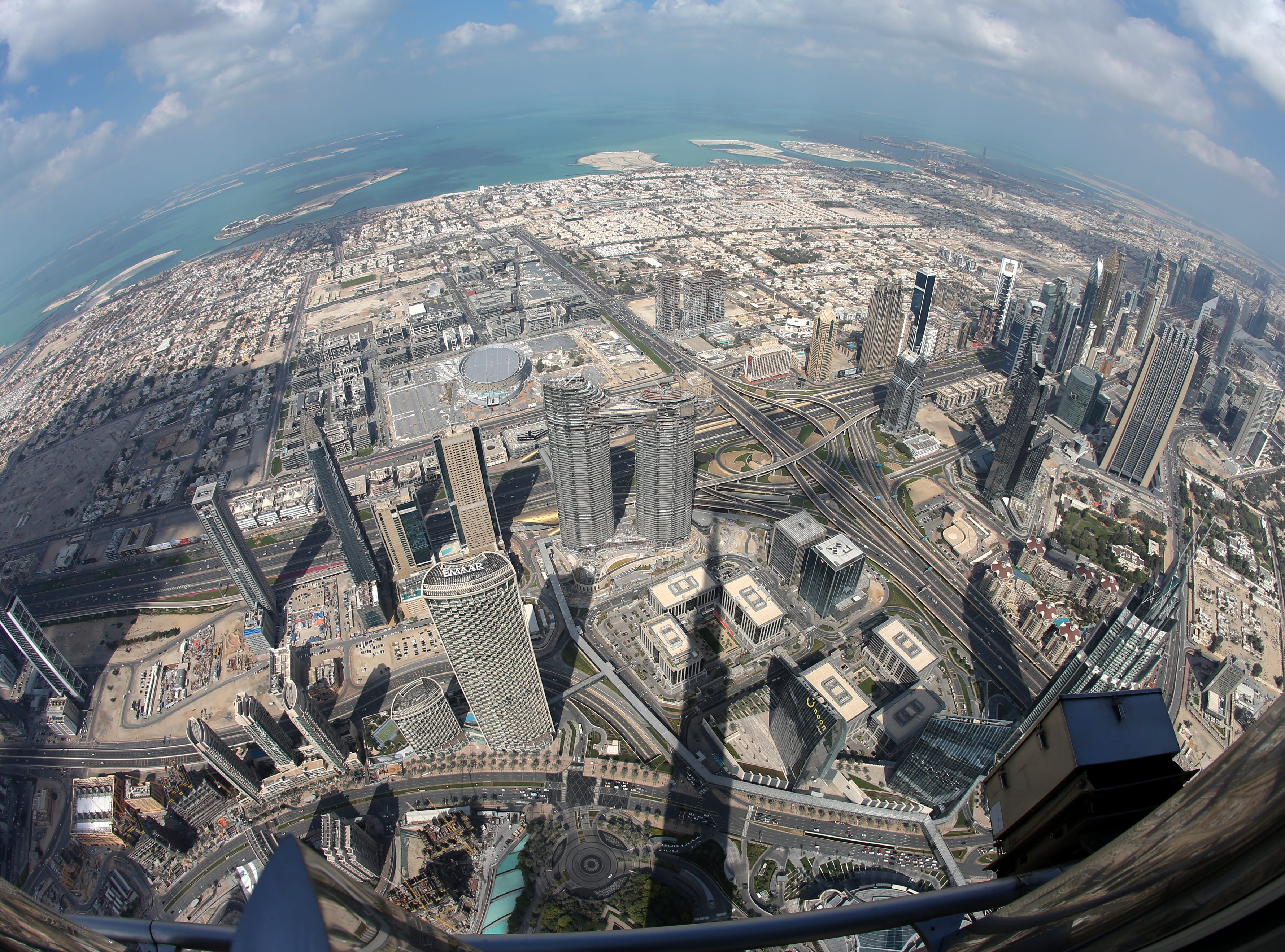 epa07367623 A picture taken with a fisheye lens shows areas close to the world's tallest building Burj Khalifa as seen from the the new highest lounge in the world at Burj Khalifa in Dubai, United Arab Emirates, 13 February 2019. Ahmad Al Falasi, Executive Director Emaar Properties announced during media briefing the opening of highest lounge in the world at Burj Khalifa located on the 152, 153, and 154 floors at 575 metres, with each have its distinctive settings assuring never before seen views of the city.  EPA-EFE/ALI HAIDER ORG XMIT: XAH051