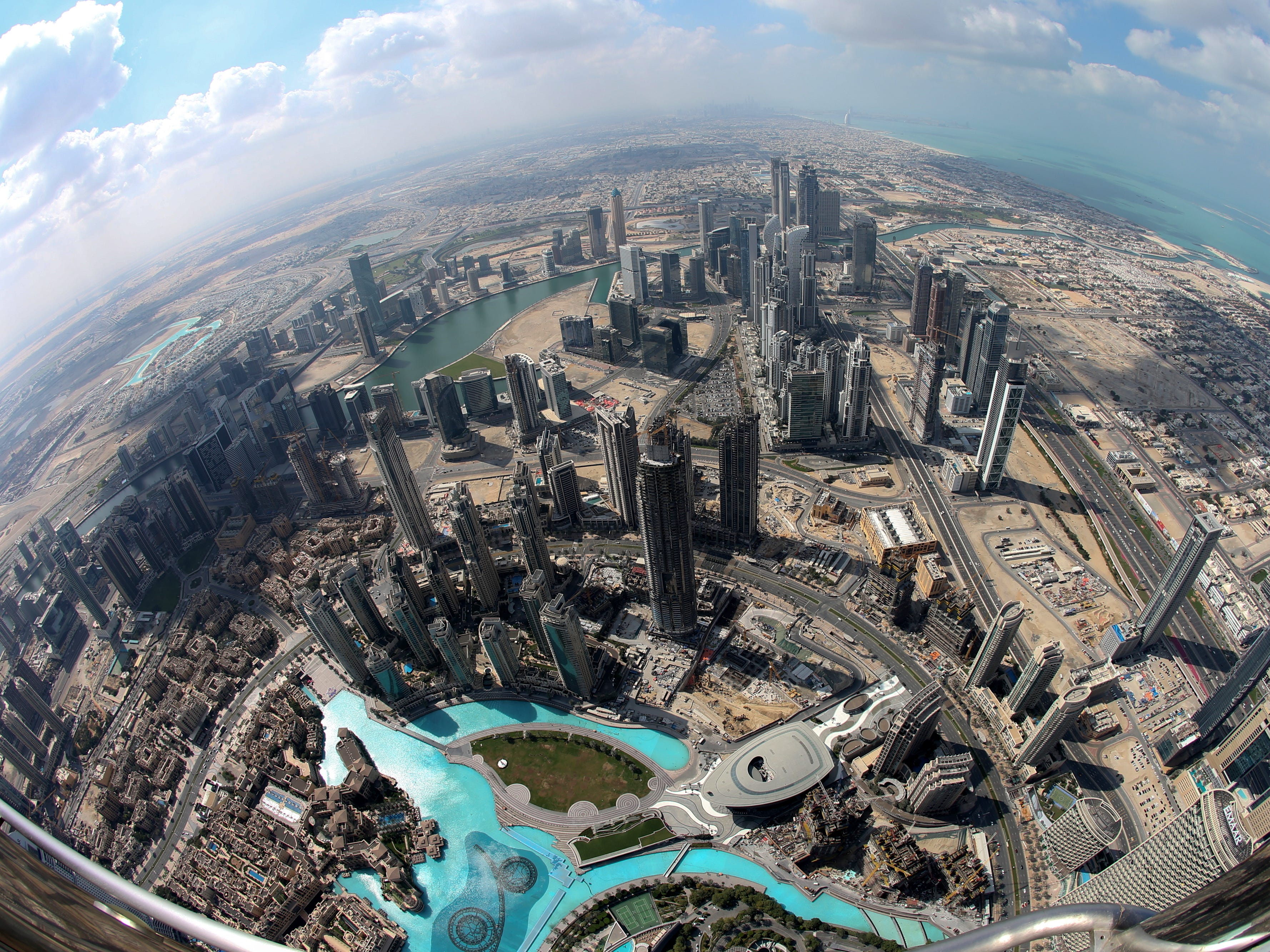 epa07367627 A picture taken with a fisheye lens shows areas close to the world's tallest building Burj Khalifa as seen from the the new highest lounge in the world at Burj Khalifa in Dubai, United Arab Emirates, 13 February 2019. Ahmad Al Falasi, Executive Director Emaar Properties announced during media briefing the opening of highest lounge in the world at Burj Khalifa located on the 152, 153, and 154 floors at 575 metres, with each have its distinctive settings assuring never before seen views of the city.  EPA-EFE/ALI HAIDER ORG XMIT: XAH051