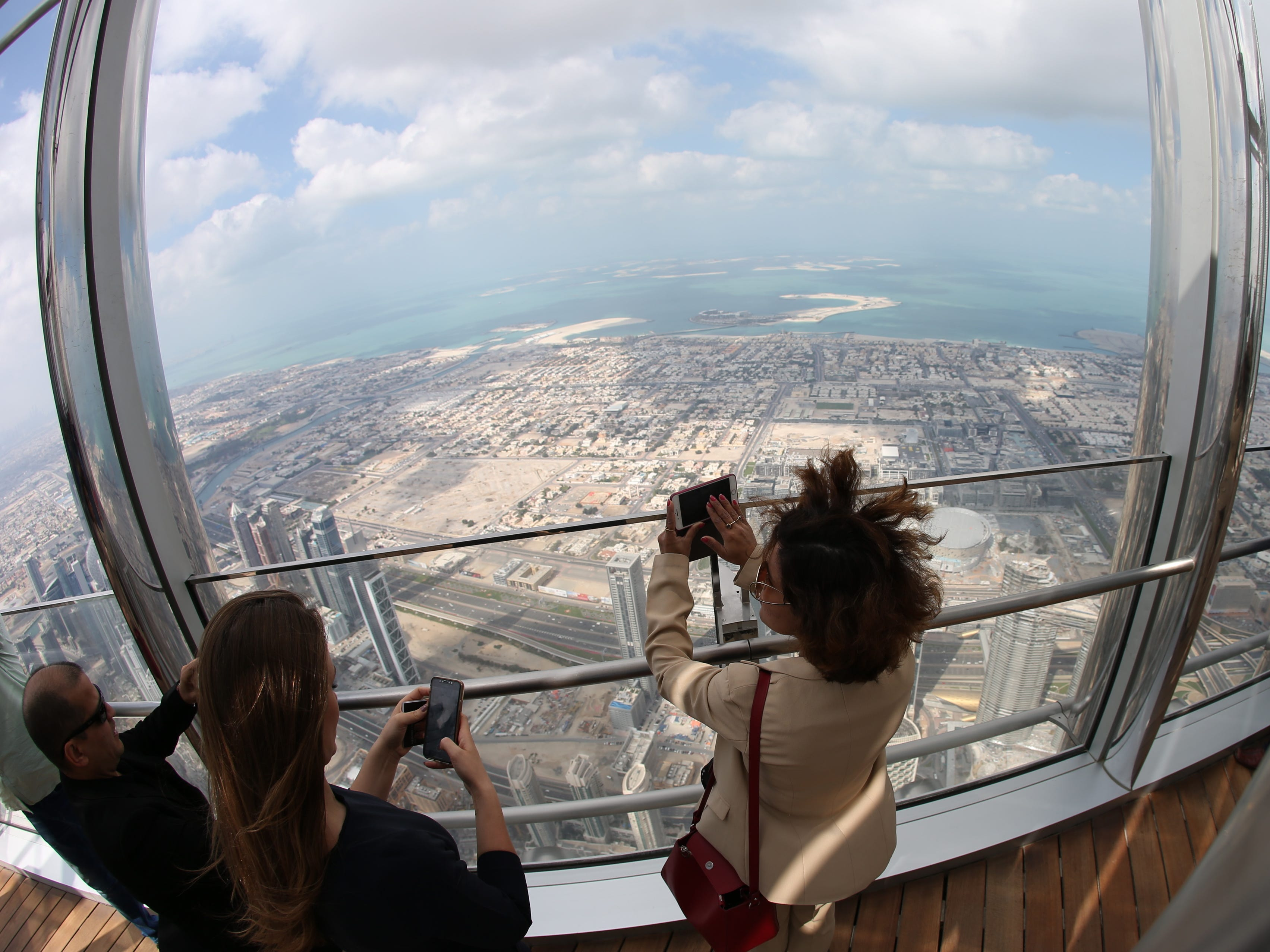 epa07366412 A picture taken with a fish eye lens shows people inspecting the new highest lounge in the world at Burj Khalifa in Dubai, United Arab Emirates, 13 February 2019. Ahmad Al Falasi, Executive Director Emaar Properties announced during media briefing the opening of highest lounge in the world at Burj Khalifa which is located at 152, 153 and 154 floor which have distinctive settings each assuring never before seen views of the city.  EPA-EFE/ALI HAIDER ORG XMIT: XAH001