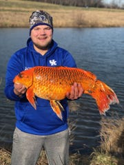 Hunter Anderson of Danville, Kentucky, poses with this massive catch that looks like a 20-pound goldfish.