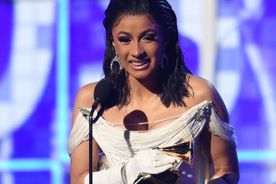 "Cardi B accepts the award for best rap album with ""Invasion Of Privacy"" onstage during the Grammys on Feb. 10, 2019, in Los Angeles."
