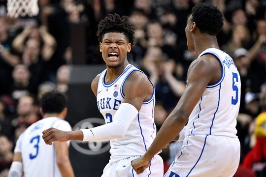 Duke Blue Devils forward Cam Reddish (2) celebrates with forward RJ Barrett (5) during the second half against the Louisville Cardinals.