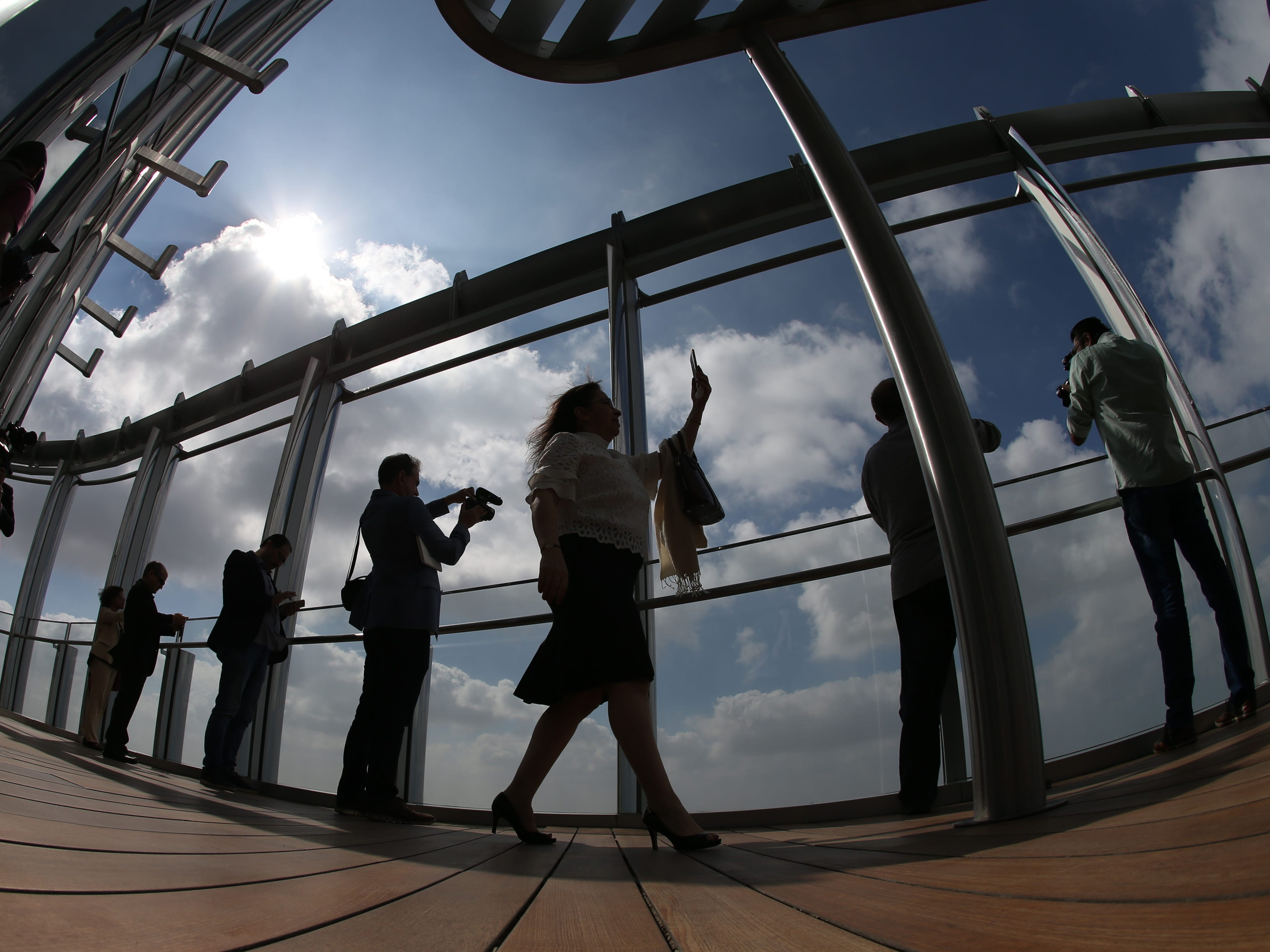 epa07366413 A picture taken with a fish eye lens shows people inspecting the new highest lounge in the world at Burj Khalifa in Dubai, United Arab Emirates, 13 February 2019. Ahmad Al Falasi, Executive Director Emaar Properties announced during media briefing the opening of highest lounge in the world at Burj Khalifa which is located at 152, 153 and 154 floor which have distinctive settings each assuring never before seen views of the city.  EPA-EFE/ALI HAIDER ORG XMIT: XAH001
