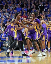 LSU players celebrate after beating Kentucky.