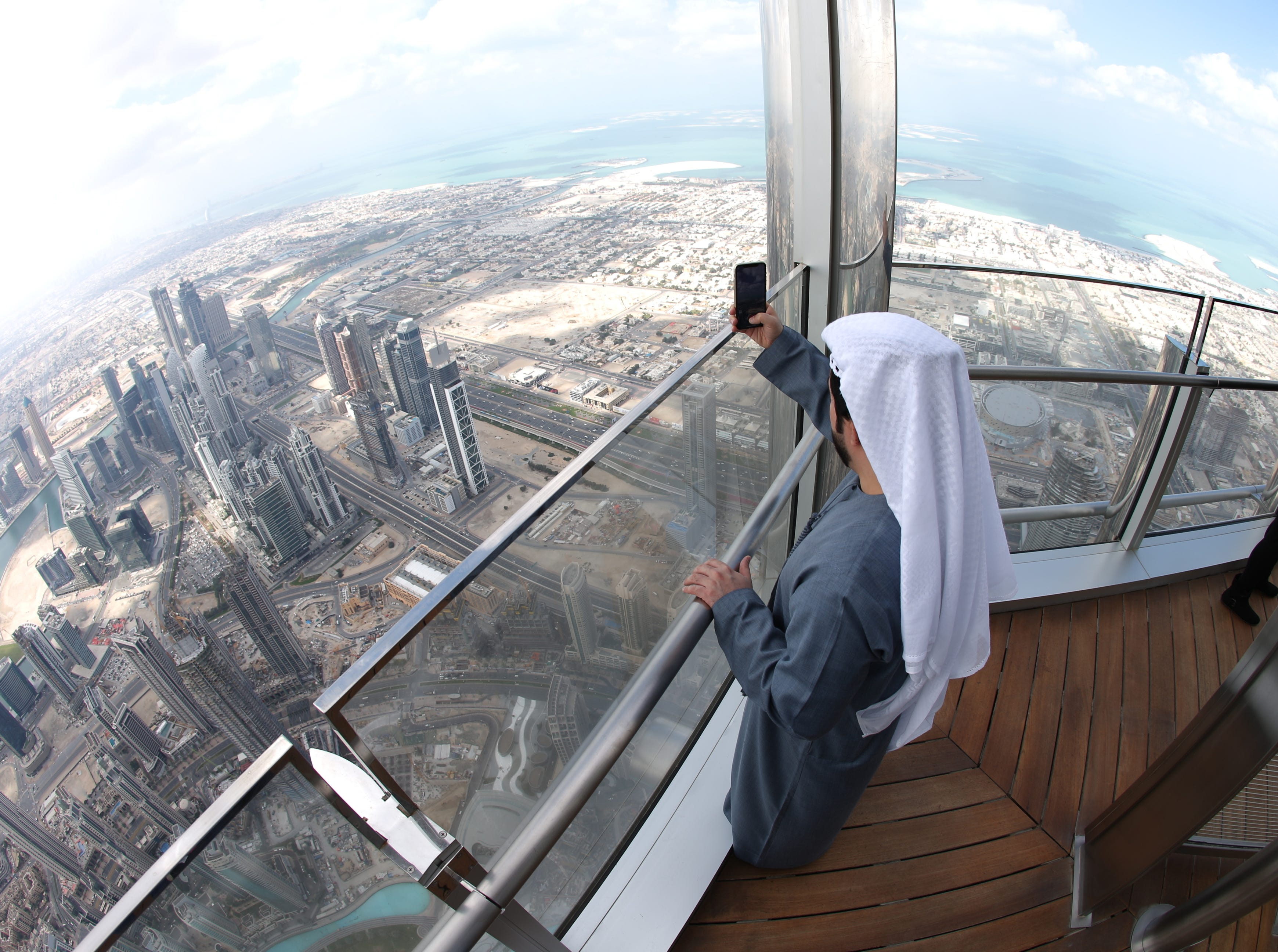 epa07366684 A picture taken with a fish eye lens shows people inspecting the new highest lounge in the world at Burj Khalifa in Dubai, United Arab Emirates, 13 February 2019. Ahmad Al Falasi, Executive Director Emaar Properties announced during media briefing the opening of highest lounge in the world at Burj Khalifa which is located at 152, 153 and 154 floor which have distinctive settings each assuring never before seen views of the city.  EPA-EFE/ALI HAIDER ORG XMIT: XAH001