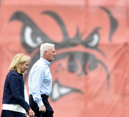 Cleveland Browns owners Jimmy and Dee Haslam leave the field during organized team activities at the Cleveland Browns training facility.